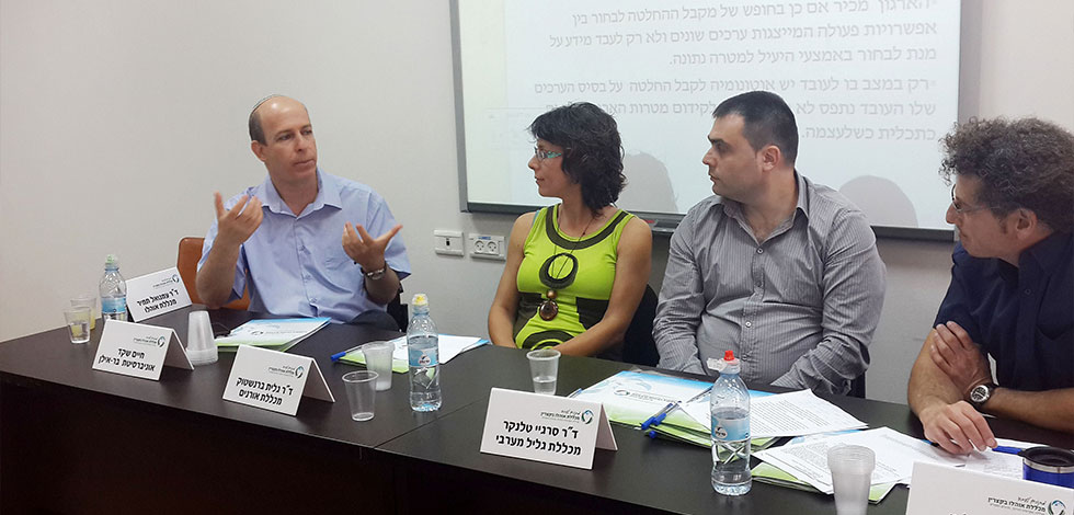 Dr. Haim Shaked at a conference